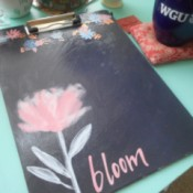 "Chic Clipboard - clip board with large flower, smaller ones, and ""bloom"""