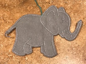 Felt Elephant Ornament - ornament lying on a laminate countertop