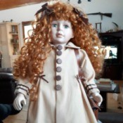 Identifying a Porcelain Doll - doll with long red curly hair and period overcoat