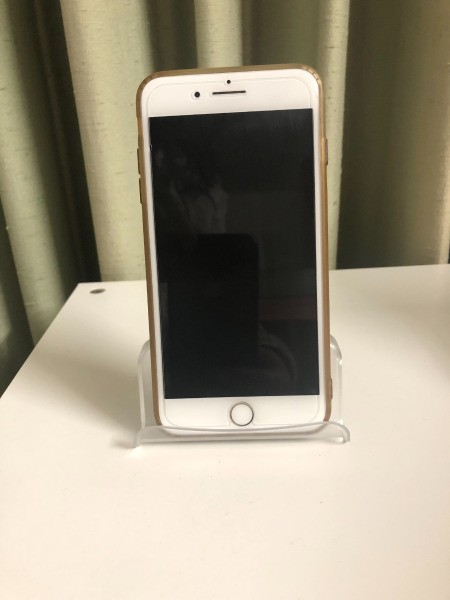 A business card holder being used as a iPhone stand.