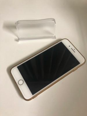 A business card holder next do a iPhone.