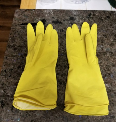 A pair of yellow kitchen gloves, doubled up.