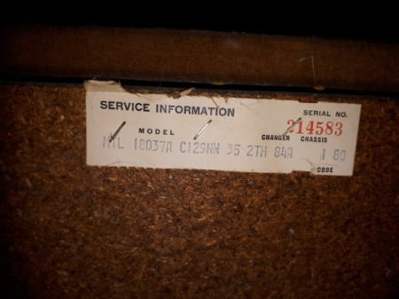 Service information tag for a console stereo system.