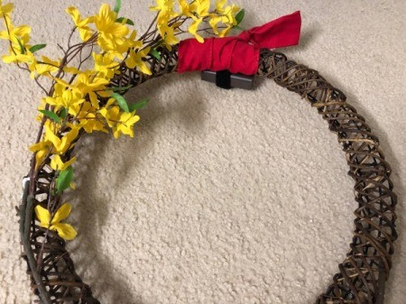 Chinese New Year Wreath 4 - one sprig of forsythia and a bit of red fabric tied at center top for a hanger