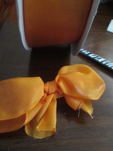 Adding Ribbon Flair To Planters - bow