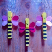 """Bee Mine"" Clothespin Craft - three finished bee clothespins"