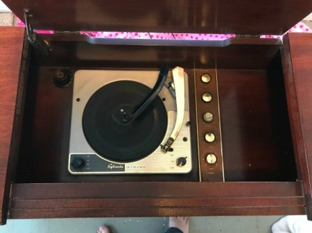 The record player in a console stereo system.