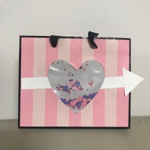 Repurpose Victoria's Secret Shopping Bag for Valentine's Day - cute pink and white striped shopping bag repurposed into a Valentine's Day gift bag