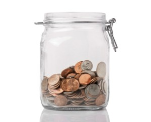 A jar of change being saved.