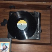 Value of a Capehart Stereo and 8 Track Player - turntable with record in place