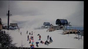 A Beech Mountain ski cam showing skiers on the mountain.
