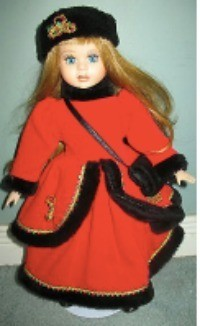 "Value of a 16"" Porcelain Vanessa Doll - doll wearing a red coat and dress trimmed with black and a black hat"