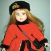 """Value of a 16"""" Porcelain Vanessa Doll - doll wearing a red coat and dress trimmed with black and a black hat"""