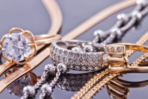 A collection of valuable jewelry on a smooth surface.