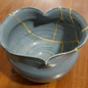 DIY Japanese Kintsugi Pottery Repair - bowl glued back together with web of gold paint showing along the repair lines
