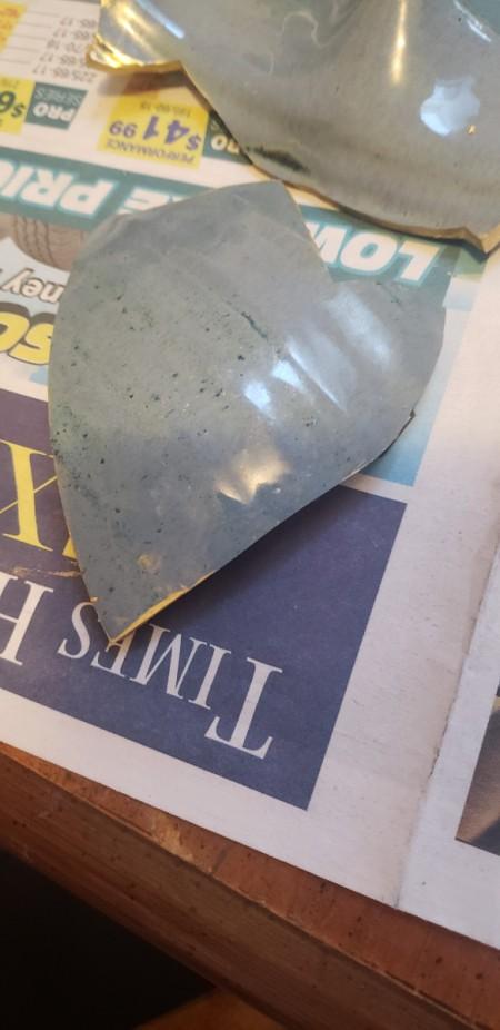 DIY Japanese Kintsugi Pottery Repair - broken pottery bowl on a sheet of newspaper