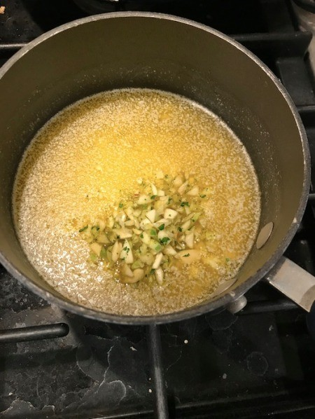 garlic added to melted butter