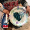 Heart Paper Plate Sewing Craft - child holding