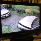A security camera showing two cars.