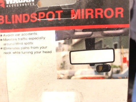 A blindspot mirror for reflecting toward the security camera.