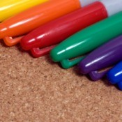 multiple caps of different color Sharpie markers