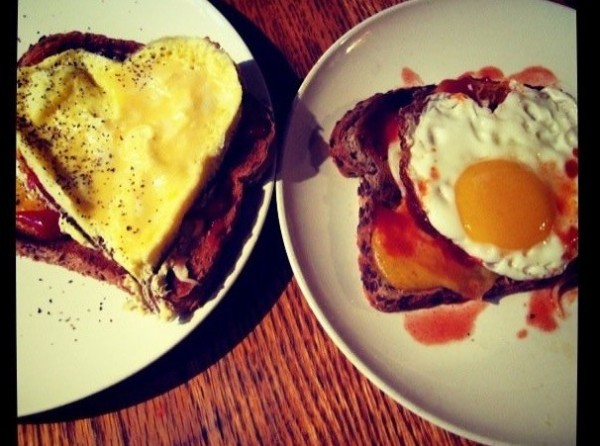 Heart shaped eggs on a plate, to celebrate an anniversary.