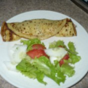 Crepe and salad on plate