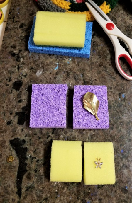 Jewelry protected between two pieces of sponge.