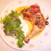 Easy Tuscan Chicken on plate with salad