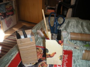 Recycled Butter Boxes Used as Pencil Holders - boxes with pens, pencils, scissors, and more inside