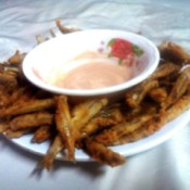 Fish Fries with bowl of sauce on plate