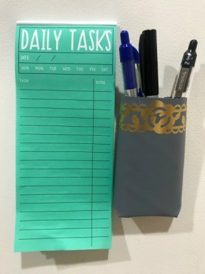 Making a Magnetic Pen/Pencil Holder - pen holder next to note pad on fridge