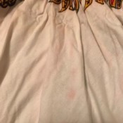 Dress Dye Ran Onto Itself - red dye transfer to white portion of a dashiki