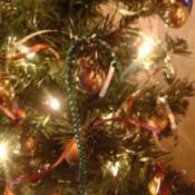 Mardi Gras beads used as candycane Christmas tree ornaments.