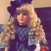 Identifying Porcelain Dolls - doll wearing dark blue satin and lace dress
