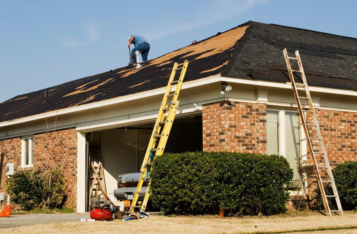 A Repair Man Fixing Leaky Roof