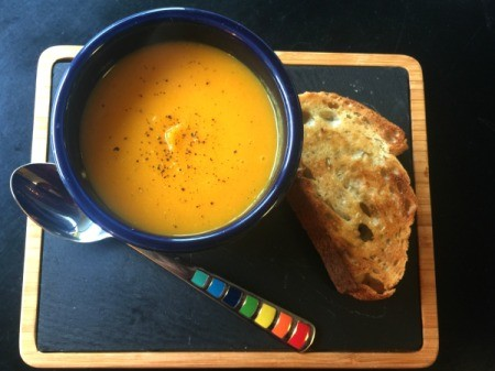 Squash Soup in bowl on tray