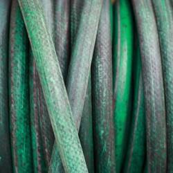 Closeup of old garden hose.