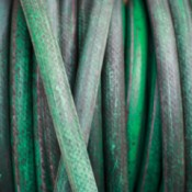 Closeup of old garden hose.