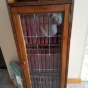 Value of 11th Edition Britannica Encyclopedia Set with Original Cabinet - leaded glass doored cabinet with encyclopedias inside