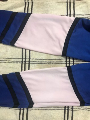 White Polyester Spandex Top Turned Pink - pinkish white area on polyester sleeves