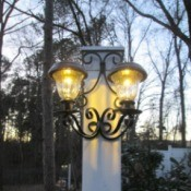 Decorative Outdoor Solar Sconces - lights on as twlight begins