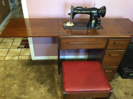 Value of a Singer 15-91 Sewing Machine - vintage machine in cabinet