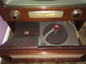 Value of a RCA Victor TV/Radio/Record Player - TV with a record player in a pull out drawer in the bottom of the cabinet