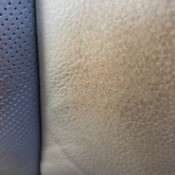 Stain on Leather Car Seat from Belt - closeup of the stain