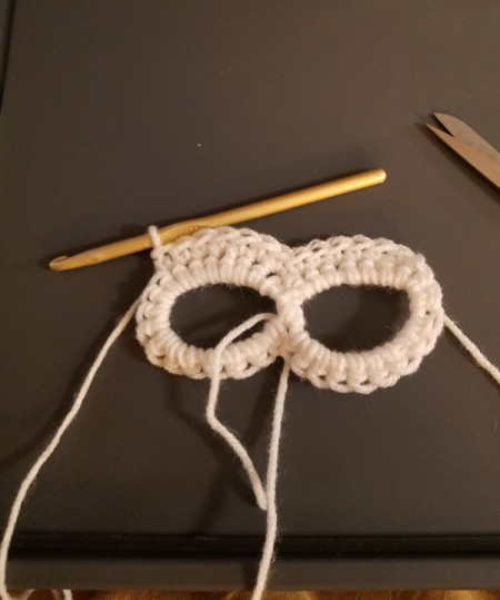 Crocheted Sugar Skull - chain 18 sc around each eye and wrap the tail around the center for stability