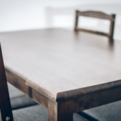 Dark wood dining table with chairs.