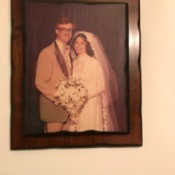A framed picture of a wedding couple.