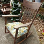 Value of a Murphy Rocking Chair - dark wood rocking chair with floral cushion