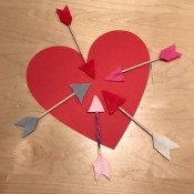 Arrow Toss Valentine's Day Toddler Game -  heart with the arrows arrayed around it